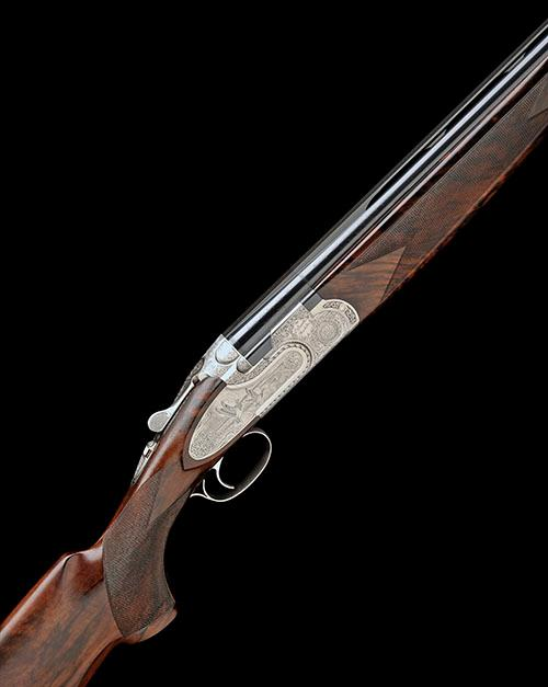 P. BERETTA A LITTLE USED SABATTI-ENGRAVED 12-BORE ''GIUBILEO'' SINGLE-TRIGGER SIDEPLATED OVER AND UNDER EJECTOR, serial no. GIU782B,