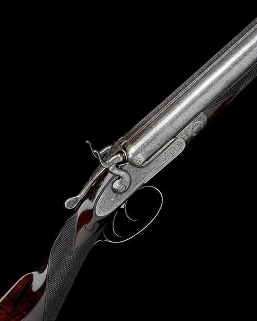 WILLIAM MOORE & GREY AN UNUSUAL 12-BORE THOMAS 1871 PATENT TOPLEVER SNAP-ACTION HAMMERGUN, serial no. 2506,