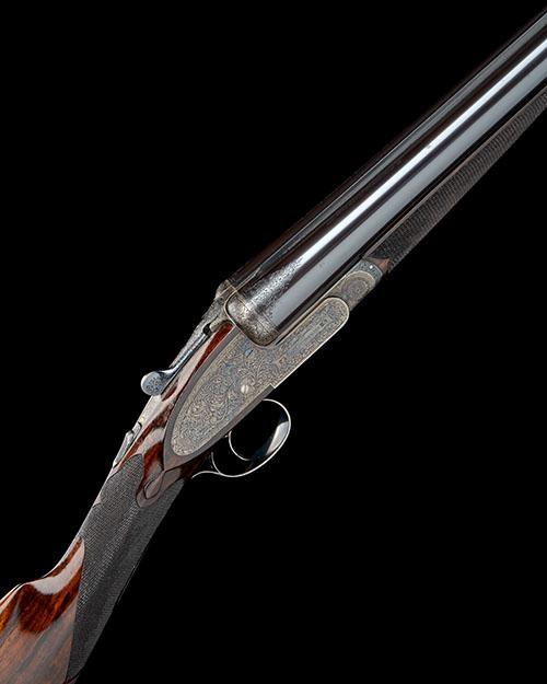 E.J. CHURCHILL A FINE 12-BORE ''PREMIERE FINEST QUALITY'' SINGLE-TRIGGER ASSISTED-OPENING PINLESS SIDELOCK EJECTOR, serial no. 6636,
