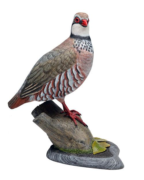 MIKE WOOD A FINE HAND CARVED AND PAINTED RED-LEGGED PARTRIDGE