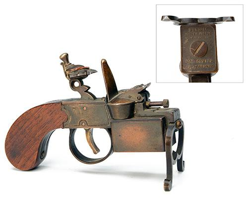 DUNHILL, LONDON A SCARCE TABLE LIGHTER IN THE FORM OF A FLINTLOCK TINDERBOX,
