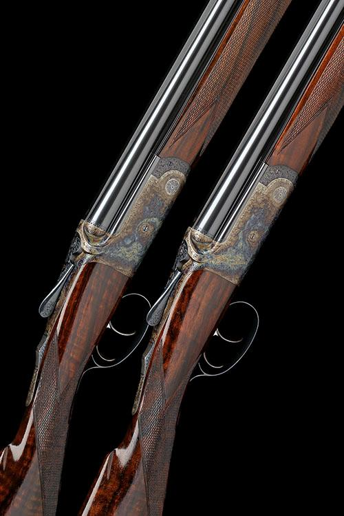 DAVID McKAY BROWN A FINE, VIRTUALLY UNUSED PAIR OF 20-BORE DOUBLE-TRIGGER OVER AND UNDER ROUND-ACTION EJECTORS, serial no. 7692 / 3,