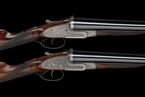 ALEXR. HENRY A MATCHED PAIR OF 12-BORE CELTIC-ENGRAVED SIDELOCK EJECTORS, serial no. 7966 / 8237,