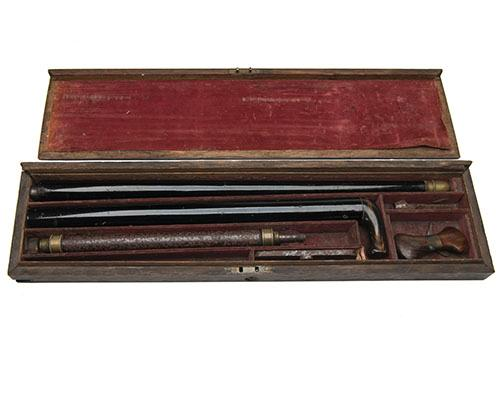 REILLY, LONDON A CASED 60-BORE PRE-CHARGED MUZZLE-LOADING PNEUMATIC AIR-CANE WITH A 100-BORE RIFLED INSERT, no visible serial number...