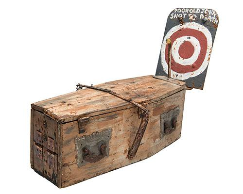 A MACABRE MECHANICAL ''SKELETON IN A COFFIN'' FAIRGROUND AIRGUN TARGET,
