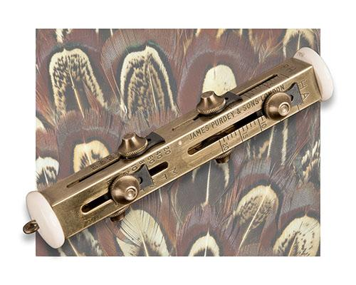 JAMES PURDEY & SONS A BRASS ''LANCASHIRE LIAR'' GAME COUNTER,