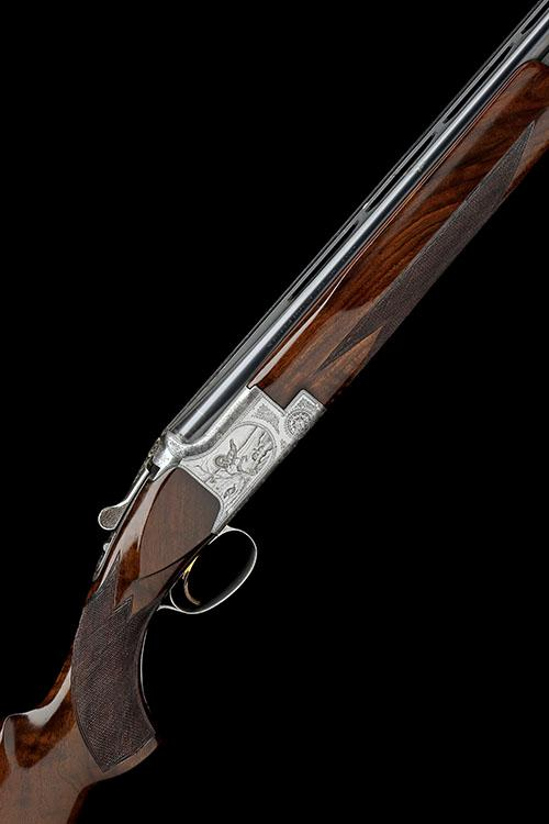 FABRIQUE NATIONALE A 12-BORE ''B2'' SINGLE-TRIGGER OVER AND UNDER EJECTOR, serial no. 11521 S72,