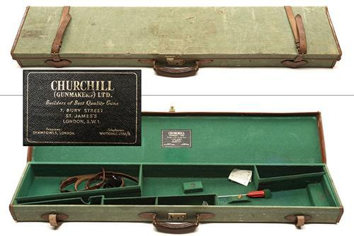 A GREEN CANVAS AND LEATHER FULL-LENGTH RIFLE CASE,