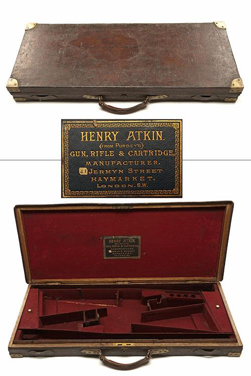 HENRY ATKIN A BRASS-CORNERED OAK AND LEATHER DOUBLE GUNCASE,
