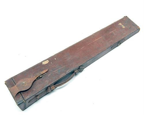 AN OAK AND LEATHER BARREL CASE,
