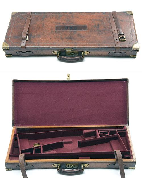A BRASS-CORNERED OAK AND LEATHER DOUBLE GUNCASE,
