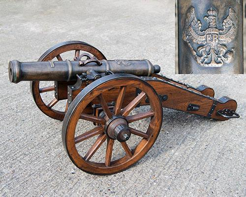 AN ATTRACTIVE MODERN INERT REPRODUCTION OF AN ELIZABETHAN CANNON,
