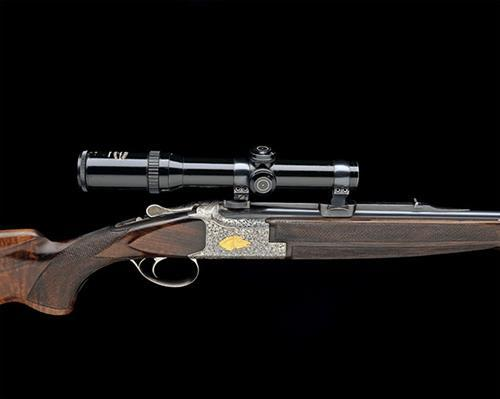 A CUSTOM 9.3X74R BROWNING B25 SINGLE-TRIGGER OVER AND UNDER EJECTOR DOUBLE RIFLE, serial no. 7000V76,