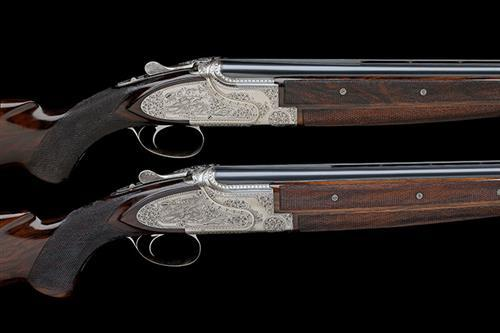 FABRIQUE NATIONALE A PAIR OF LODEWIC-ENGRAVED 12-BORE SINGLE-TRIGGER SIDEPLATED OVER AND UNDER EJECTORS, serial no. 751919 / 20,