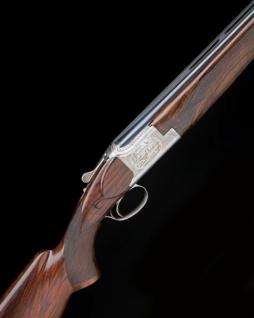 FABRIQUE NATIONALE A 12-BORE ''C2'' SINGLE-TRIGGER OVER AND UNDER EJECTOR, serial no. 58200 S76,