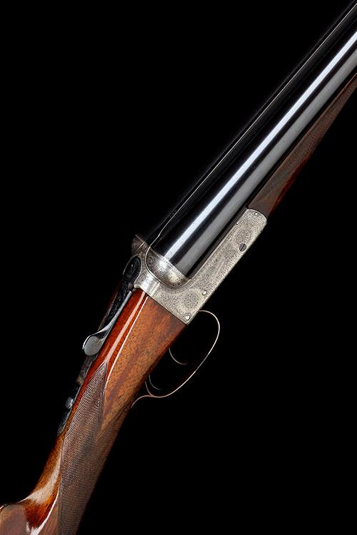 E.J. CHURCHILL A 12-BORE ''UTILITY XXV MODEL'' BOXLOCK EJECTOR, serial no. 3044,