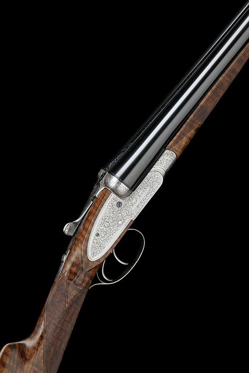 WILLIAM EVANS A 12-BORE SIDELOCK EJECTOR, serial no. 12030, with extra barrels,