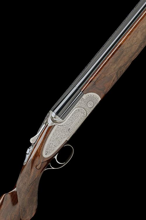 WILLIAM EVANS A 12-BORE (3IN.) ''ST. JAMES'' SINGLE-TRIGGER SIDEPLATED OVER AND UNDER EJECTOR, serial no. 20326,