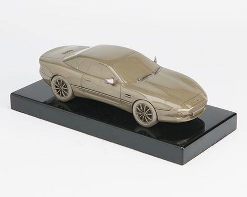 ANTHONY HOLT & SONS A FINE MOUNTED COLD CAST BRONZE OF AN ASTON MARTIN DB7,