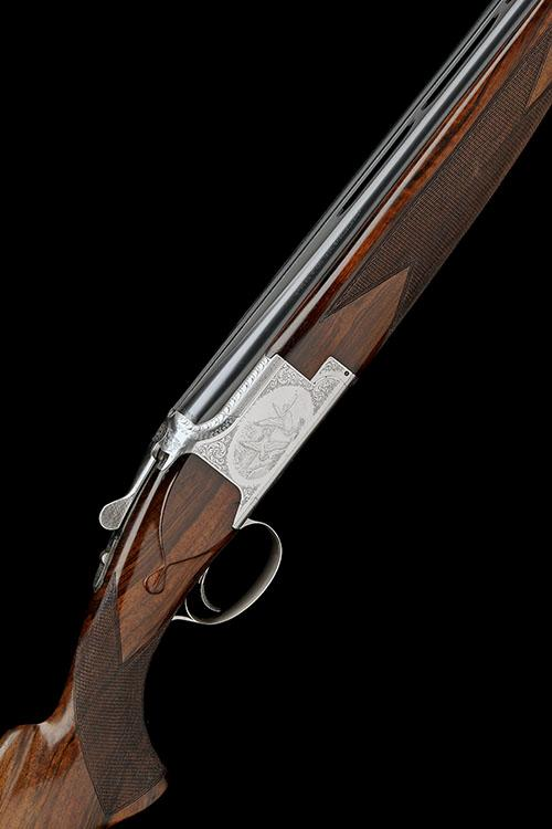 BROWNING ARMS COMPANY A POES-ENGRAVED 12-BORE SINGLE-TRIGGER OVER AND UNDER EJECTOR, serial no. 8J3PT07215,