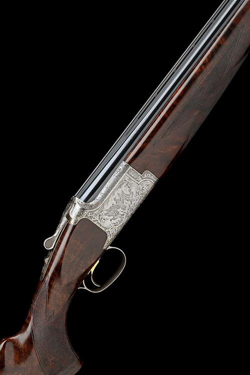 BROWNING A 12-BORE SINGLE-TRIGGER OVER AND UNDER EJECTOR, serial 38620NT,