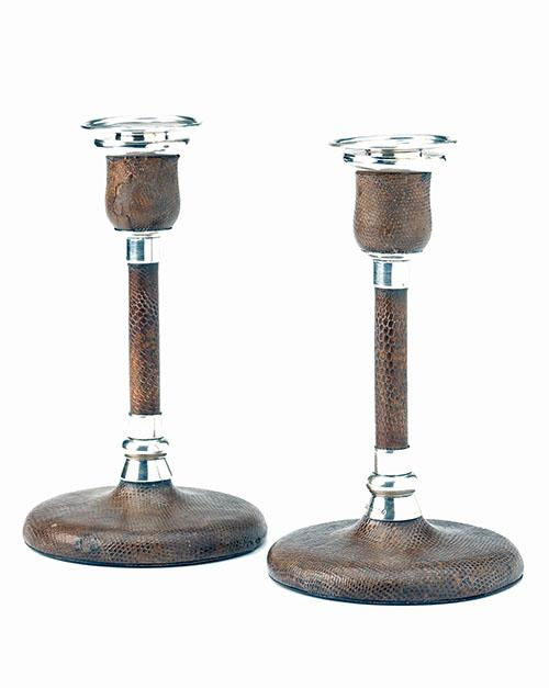 A VINTAGE PAIR OF STERLING SILVER AND SNAKE-SKIN BOUND CANDLE STICKS,