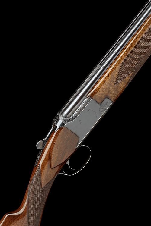 FABRIQUE NATIONALE A 12-BORE ''A1'' SINGLE-TRIGGER OVER AND UNDER EJECTOR, serial no. 16448S73,