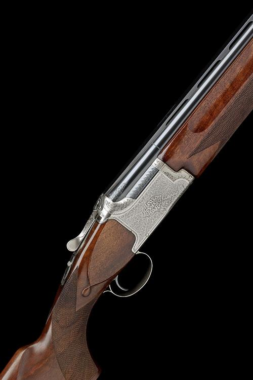 WINCHESTER A 12-BORE ''GRAND EUROPEAN'' SINGLE-TRIGGER OVER AND UNDER EJECTOR, serial no. K450330,