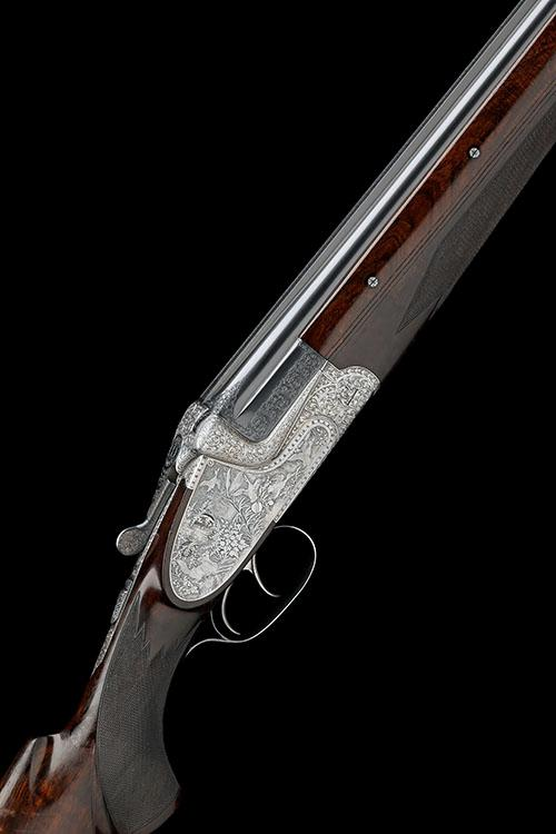 GEBRUDER MERKEL A 12-BORE ''MODEL 303E'' DOUBLE-TRIGGER OVER AND UNDER HAND-DETACHABLE SIDELOCK EJECTOR, serial no. 96570,