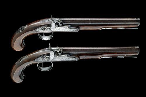 TOW, LONDON A CASED PAIR OF 25-BORE PERCUSSION DUELLING-PISTOLS, no visible serial numbers,