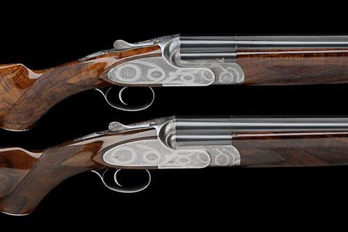 FAMARS A PAIR OF PASOLINI-ENGRAVED 12-BORE ''EXCALIBUR SL'' SINGLE-TRIGGER OVER AND UNDER SIDELOCK EJECTORS, serial no. S0068 / 69,