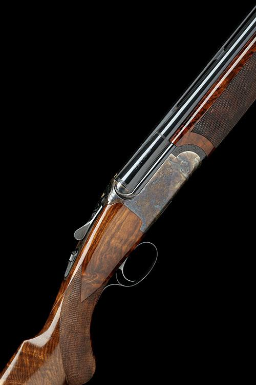 RIZZINI A 12-BORE (3IN.) ''ROUND BODY'' SINGLE-TRIGGER OVER AND UNDER EJECTOR, serial no. 66700,