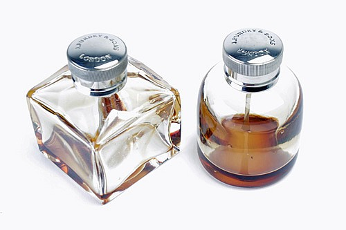 JAMES PURDEY AND SONS TWO VINTAGE GLASS OIL BOTTLES,