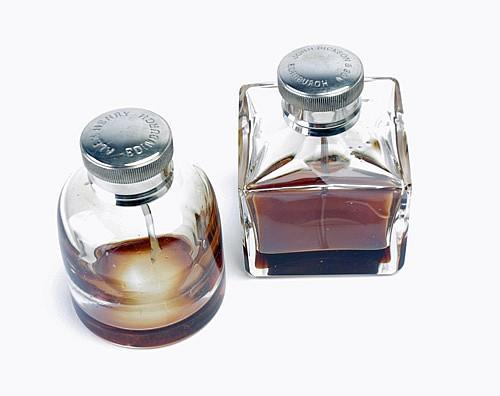 TWO VINTAGE GLASS OIL BOTTLES,