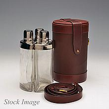 † JAMES PURDEY & SONS A NEW AND UNUSED THREE FLASK TRAVEL BAR IN A CHEQUERED LEATHER CASE,