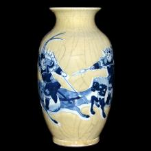 Korea,  Joseon Dynasty, 18th C.  Celadon-Ground with Molded Underglazed Blue Lantern Vase of Battle Scene on Horseback