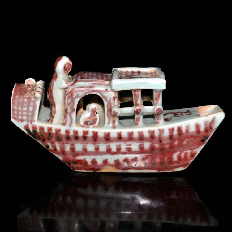 元 釉里红塑雕人物船形水注 Yuan, An Underglazed Copper-Red Boat-Shape Water Dropper