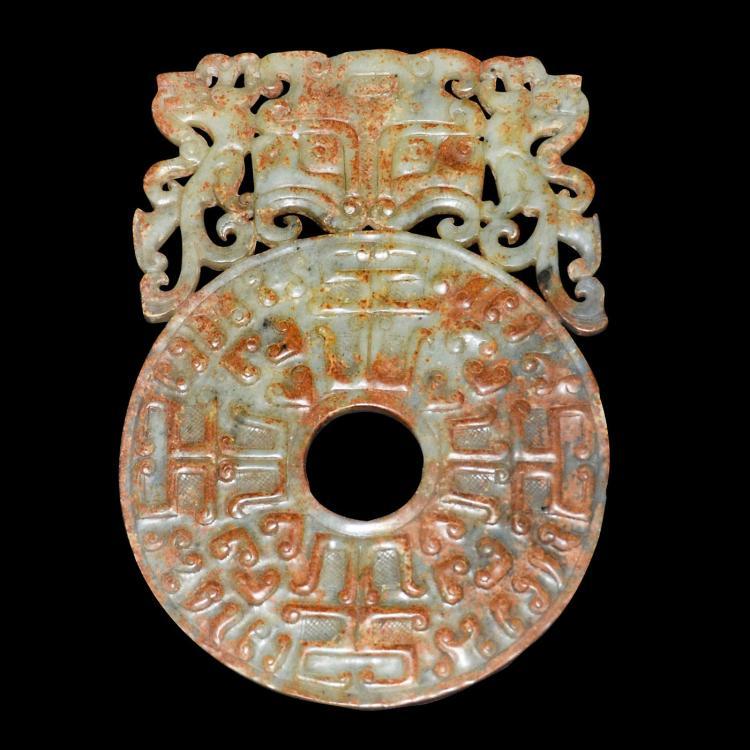 汉 双面浮雕兽首勾云纹两兽拱璧 Han, Archaistic Jade Bi