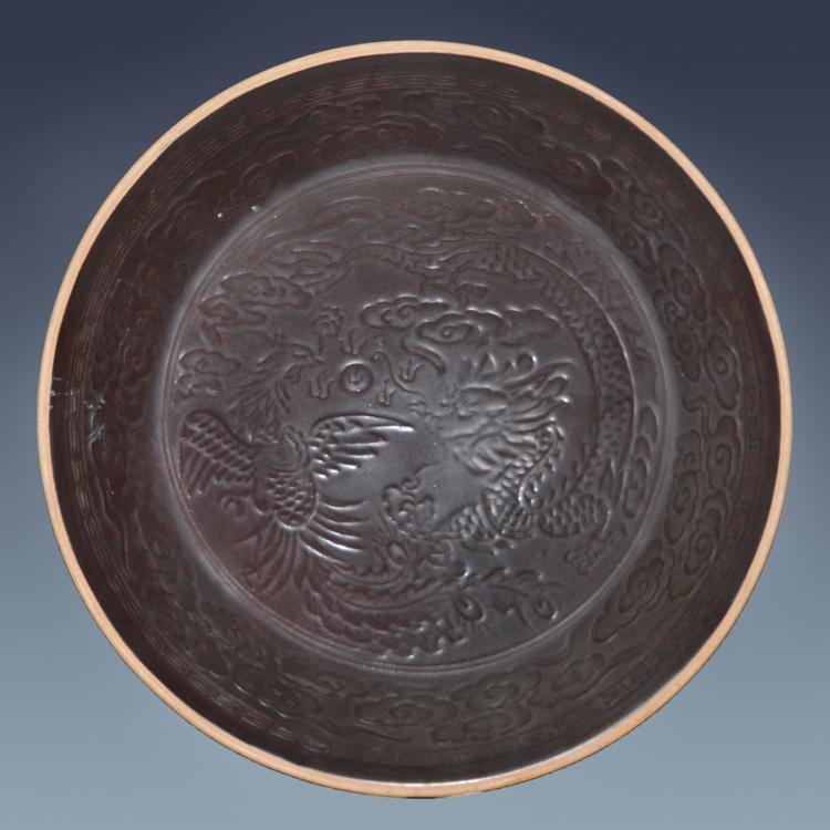 宋 定窑 紫金酱釉印花龙凤纹大盘 Song, A Rare and Large Molded Dingyao Dragon-Phoenix Plate
