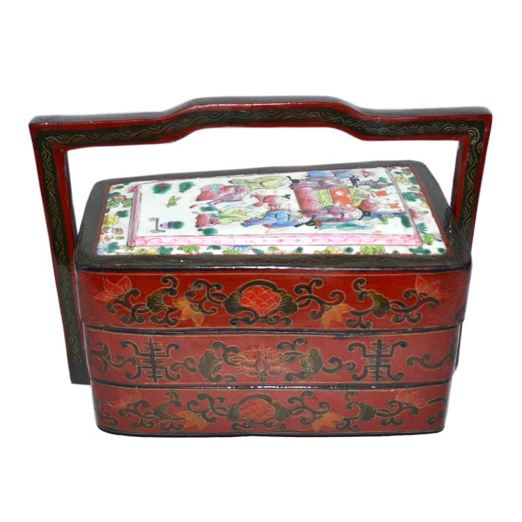 清 漆雕花卉瓷面人物提樑双层扇形盖盒 Qing, A Lacquer Tiered Fan-Shaped Picnic Box Carved with Famille-Rose Enamel Cover