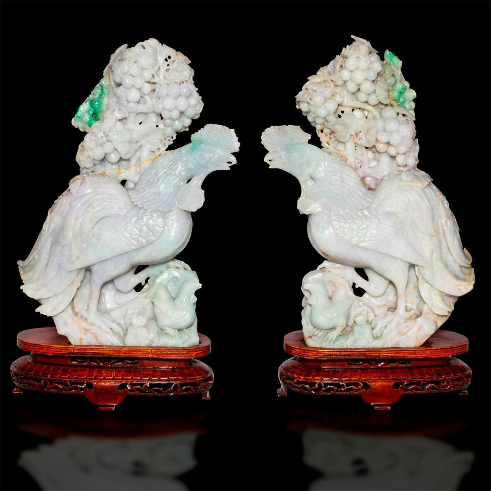 PAIR OF CHINESE CARVED JADE CROWING ROOSTERS, WOODEN STANDS