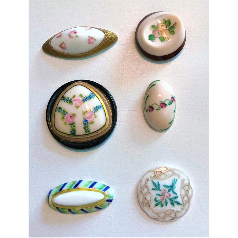 A SMALL CARD OF DIV. ONE PAINTED WHITE GLASS BUTTONS