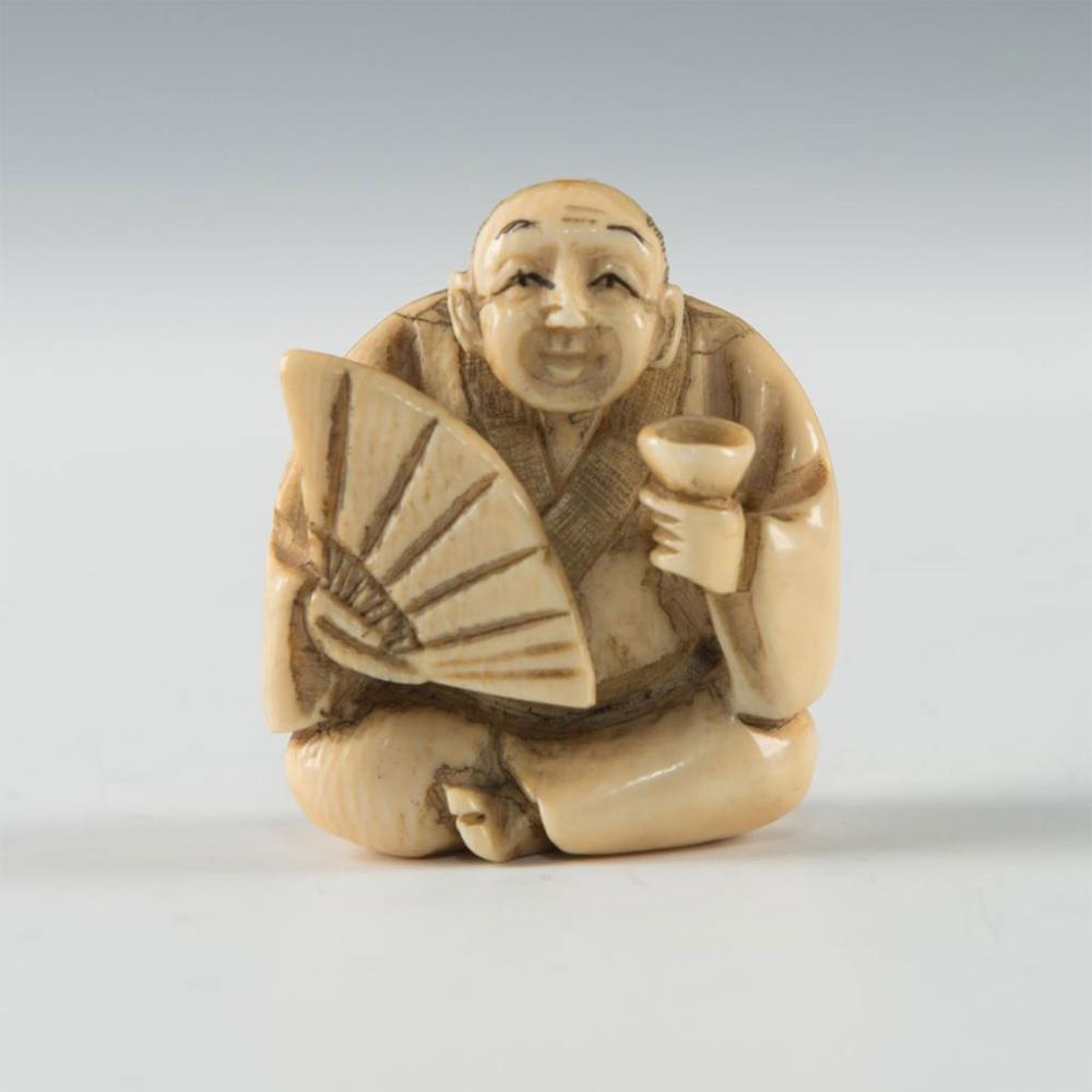 Antique Japanese Carved Bone Netsuke Man With A Fan