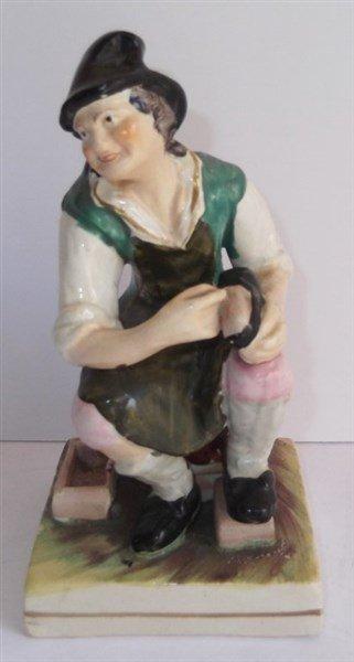Vintage Staffordshire cobbler & dog figure