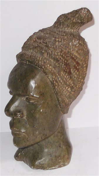Stone carved african tanzania woman s head
