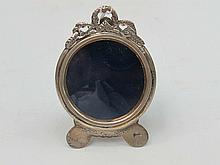 A miniature HM silver circular photoframe, easel