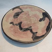 A turned mineral platter with hand applied