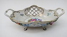 A Dresden china ornate flower encrusted basket,