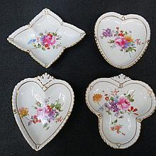 A set of four Royal Crown Derby card suit dishes