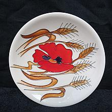 A Moorcroft dish with harvest poppy design 12cm.